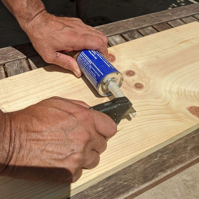 Cutting a tube of caulk