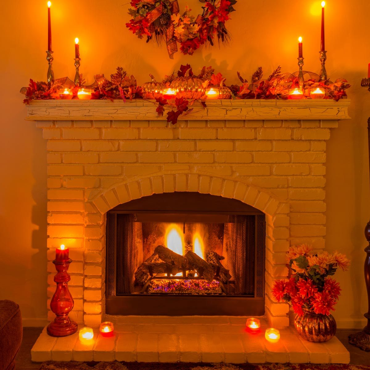 Cozy Brick fireplace with fall decorations and candles Thanksgiving mantel