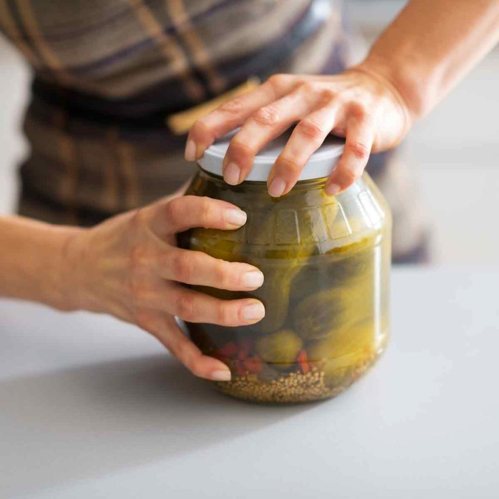 Woman-tries-to-open-a-pickle-jar