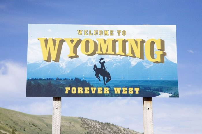 Close-up of welcome to Wyoming road sign