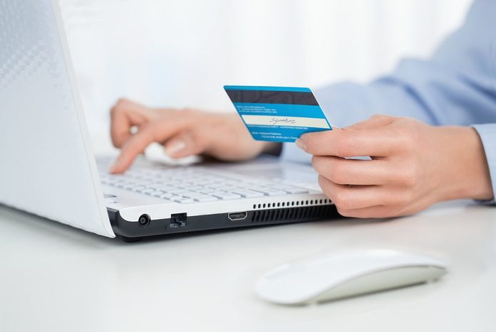 Close up of female hands making online payment