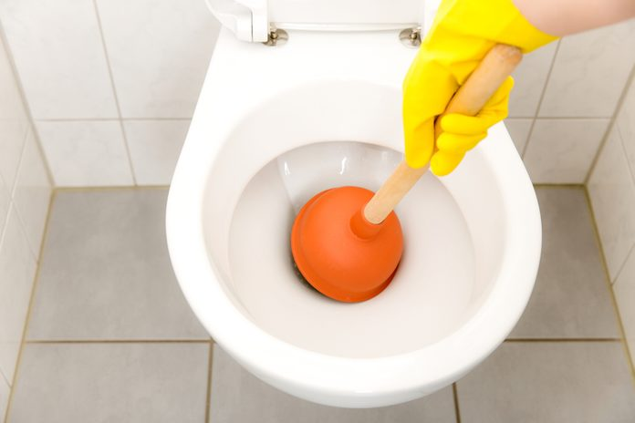 Toilet clogged - bathroom - Plunger