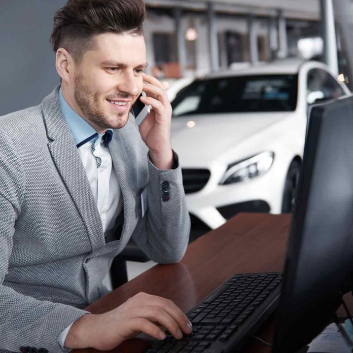 Car-dealer-on-the-phone-talking-with-client