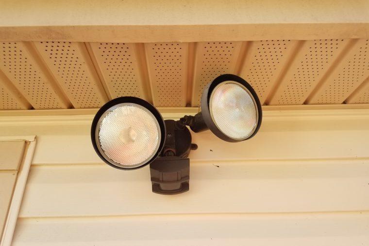 outdoor motion sensor flood light under the eaves of a house