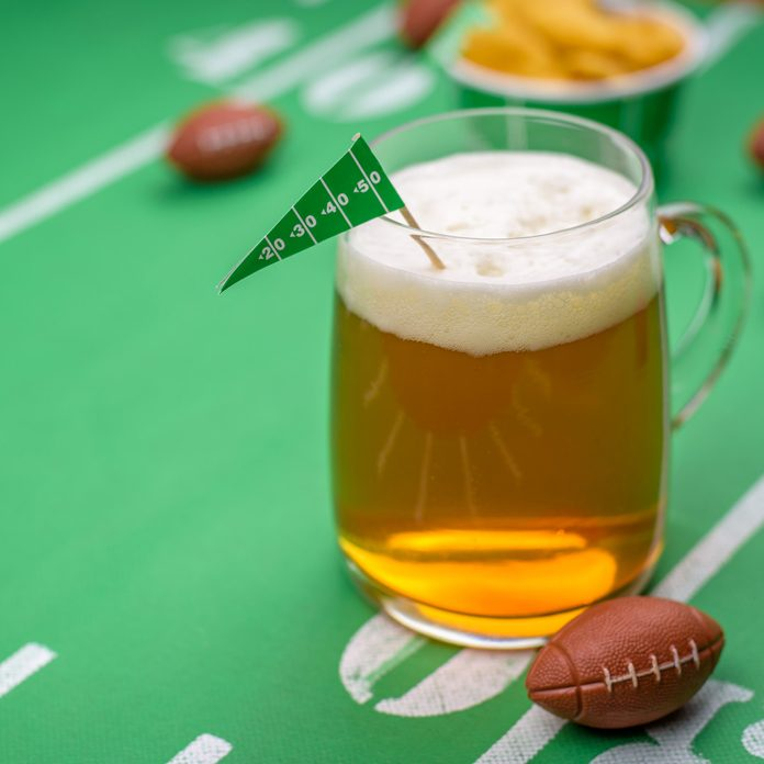 Big game day party table with mug of beer football