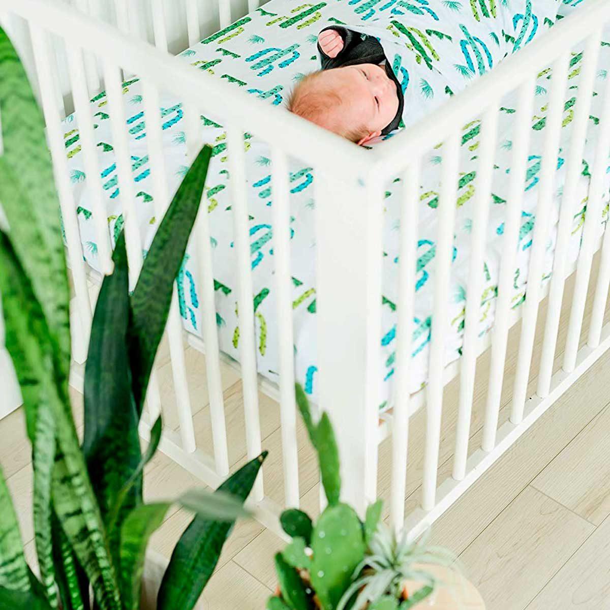 crib with cactus sheet