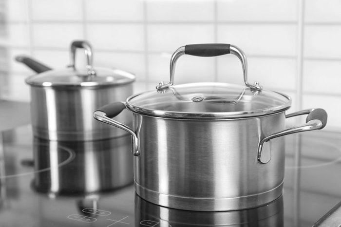 Metal saucepan on electric stove in kitchen