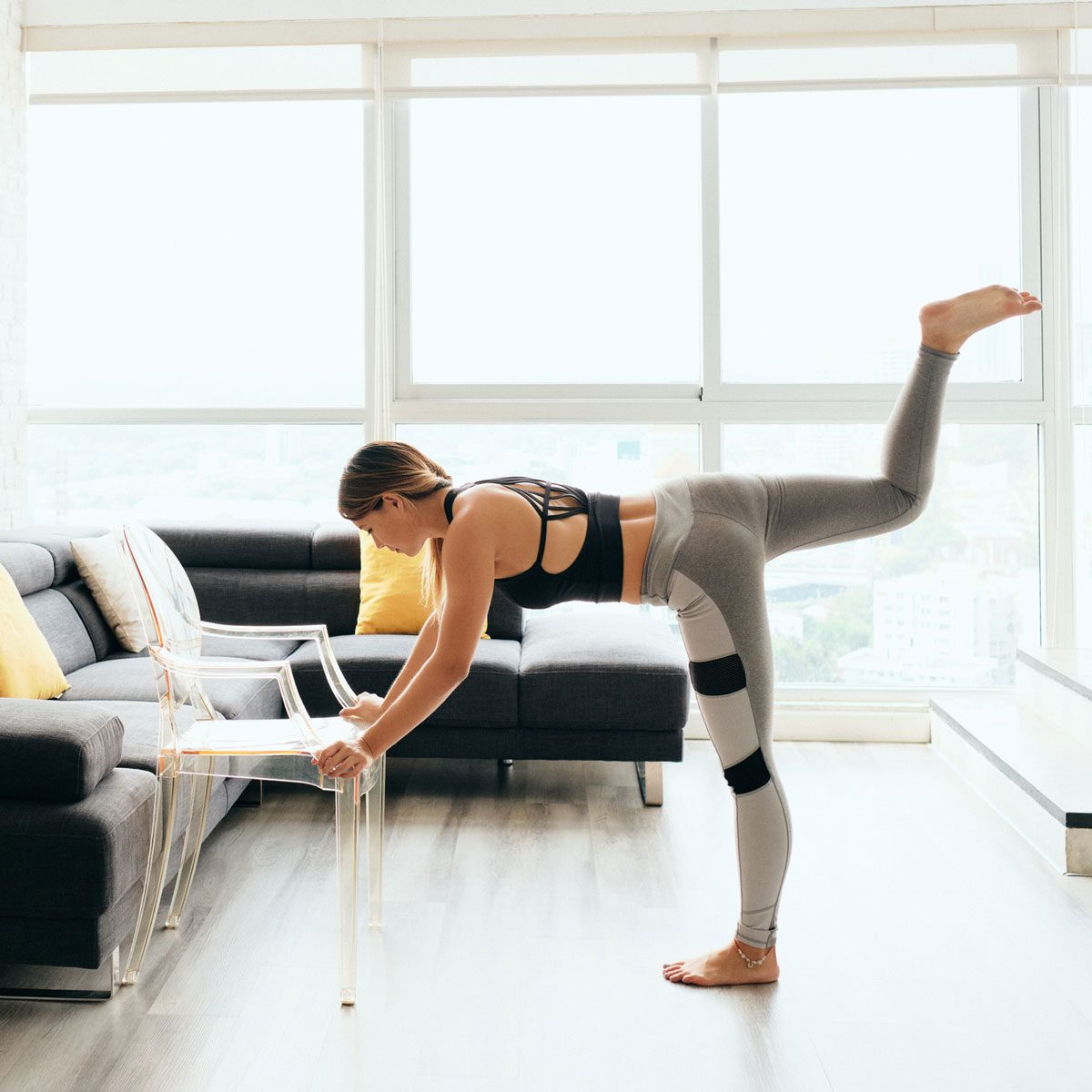 Woman exercising with a chair