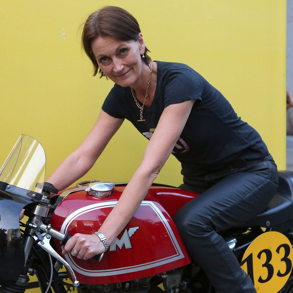 Portrait of Elspeth Beard on a motorcycle