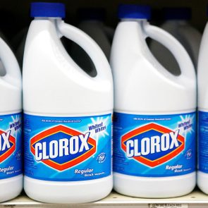 bottles of Clorox on a shelf in a grocery store