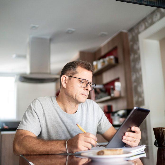 Man reading Reddit home improvement tips on a tablet