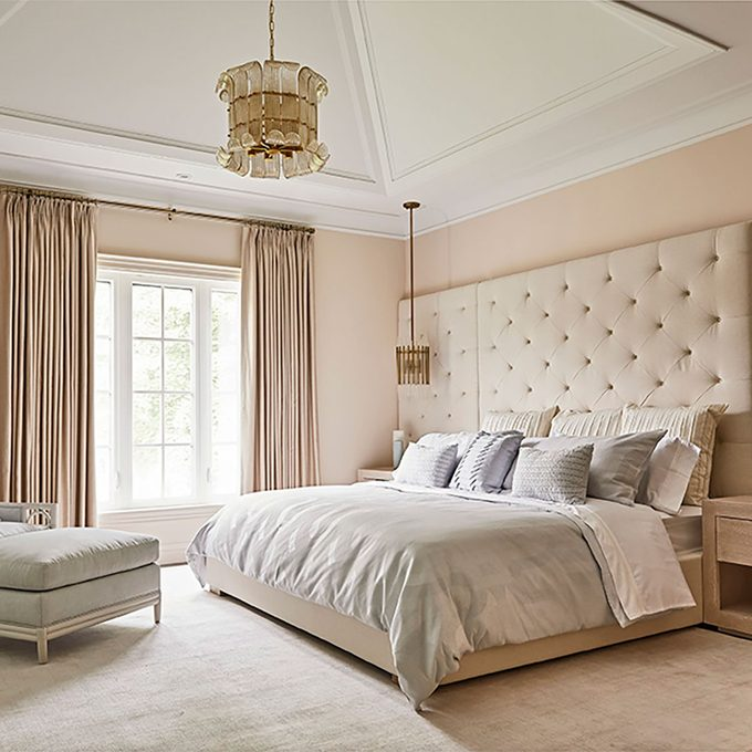 Bedroom with blush walls and cream furnishings