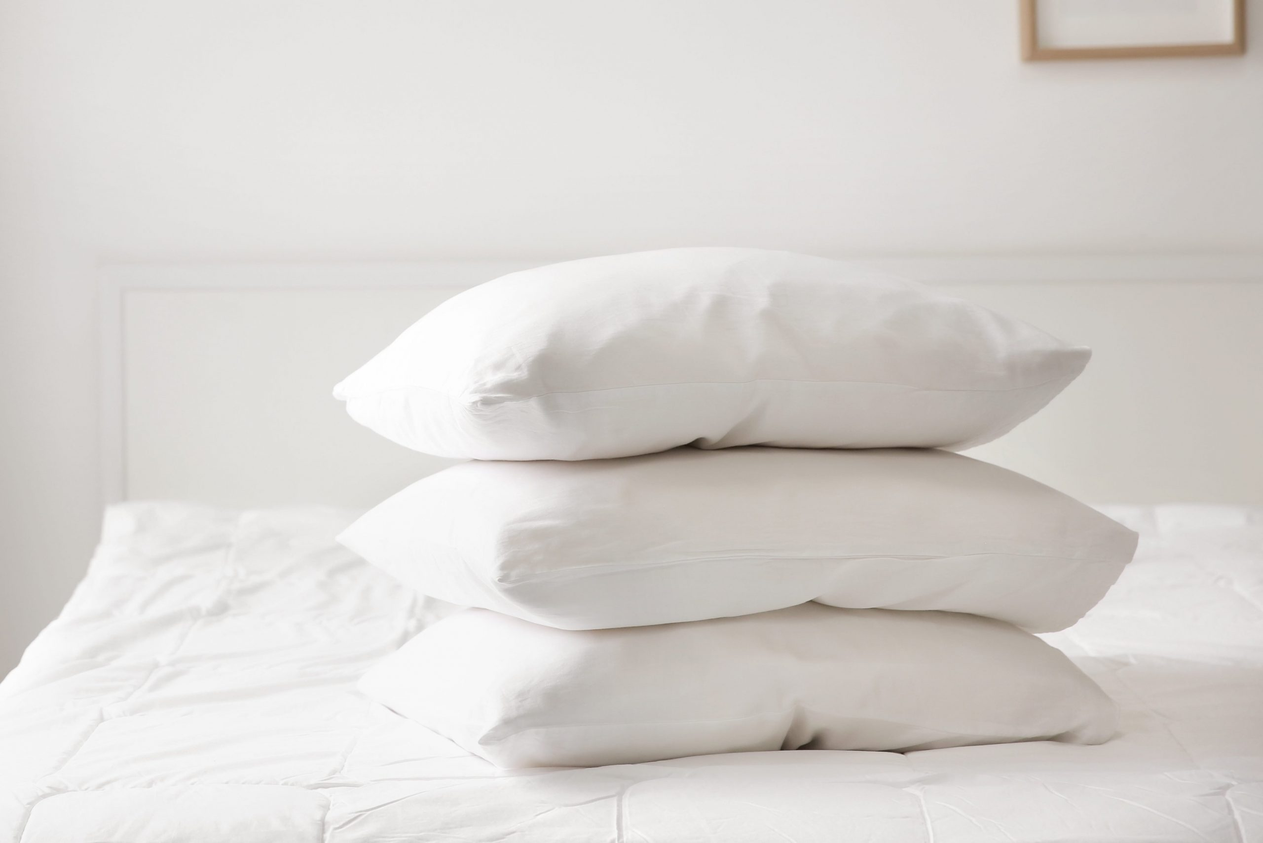 Stack of pillows on bed