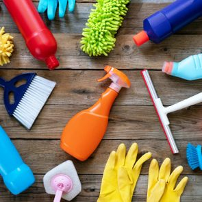 cleaning tools spray bottle gloves House cleaning product on wood table