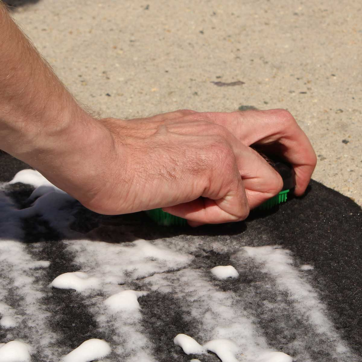 scrubbing car mats