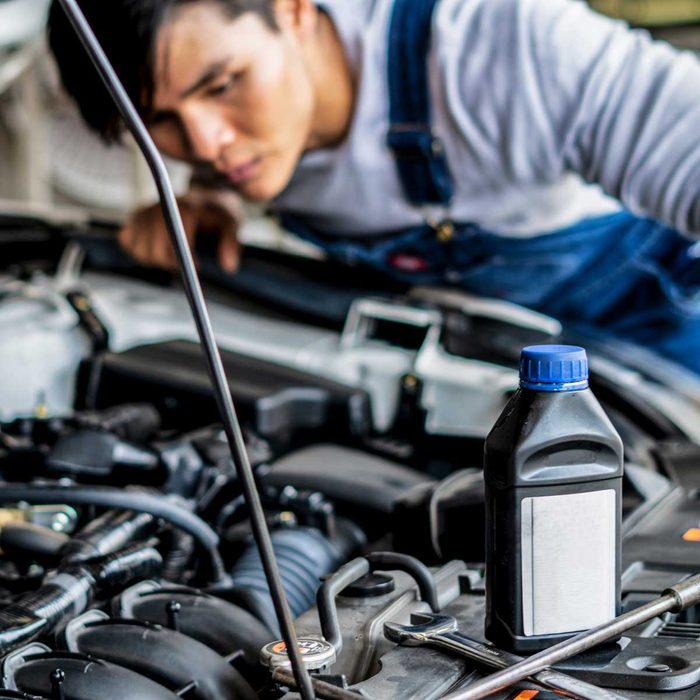 Man changing motor oil