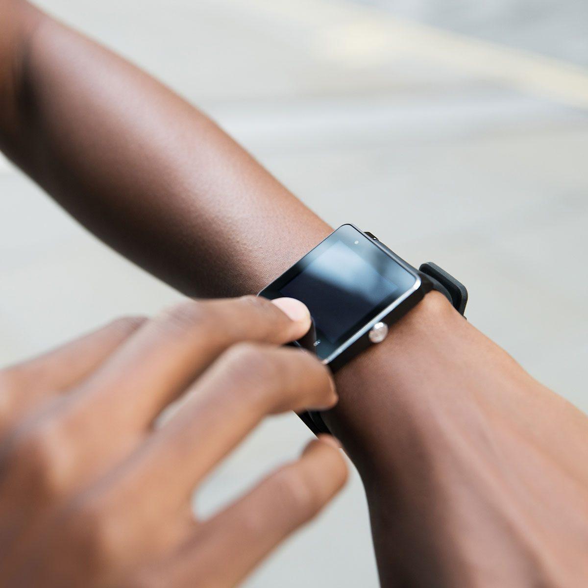 Woman using smart watch
