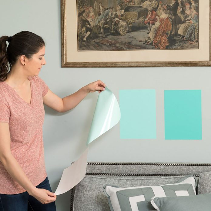 Woman adding SureSwatch to her walls