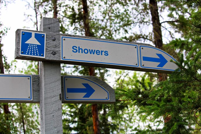 A direction sign for showers at a campground