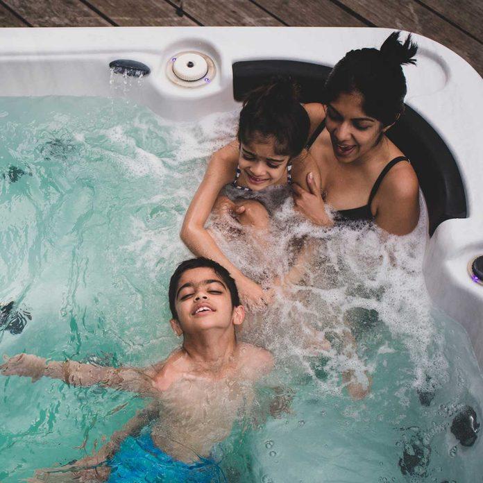 Family enjoying a hot tub