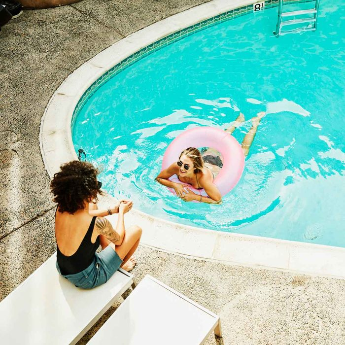 Two women at a pool