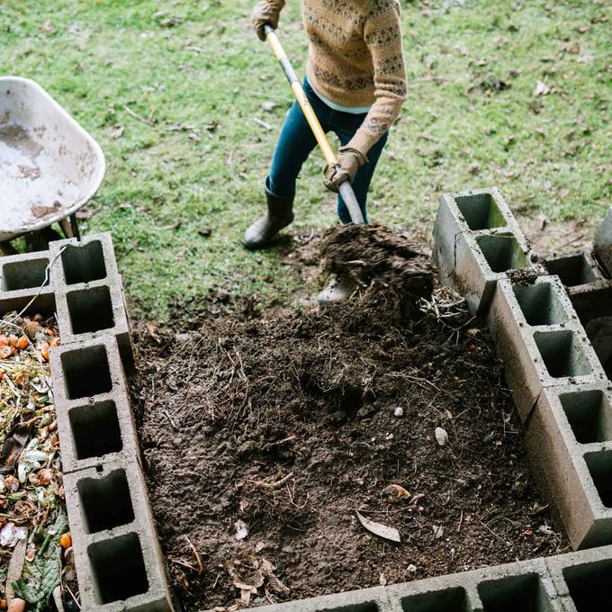 Scooping compost