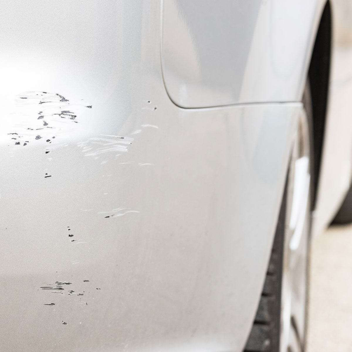 Chipped paint on a white car