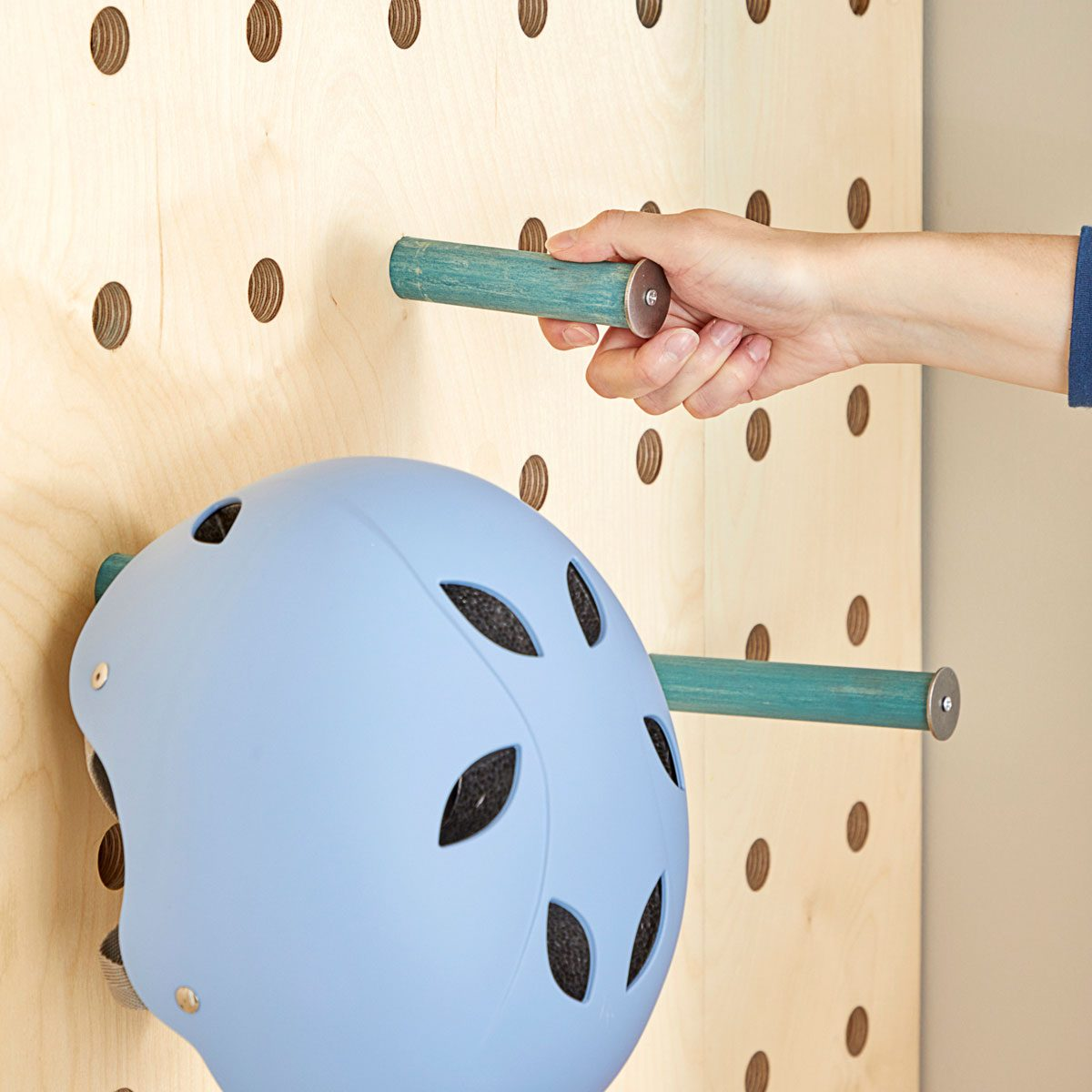 Inserting pegs into wall