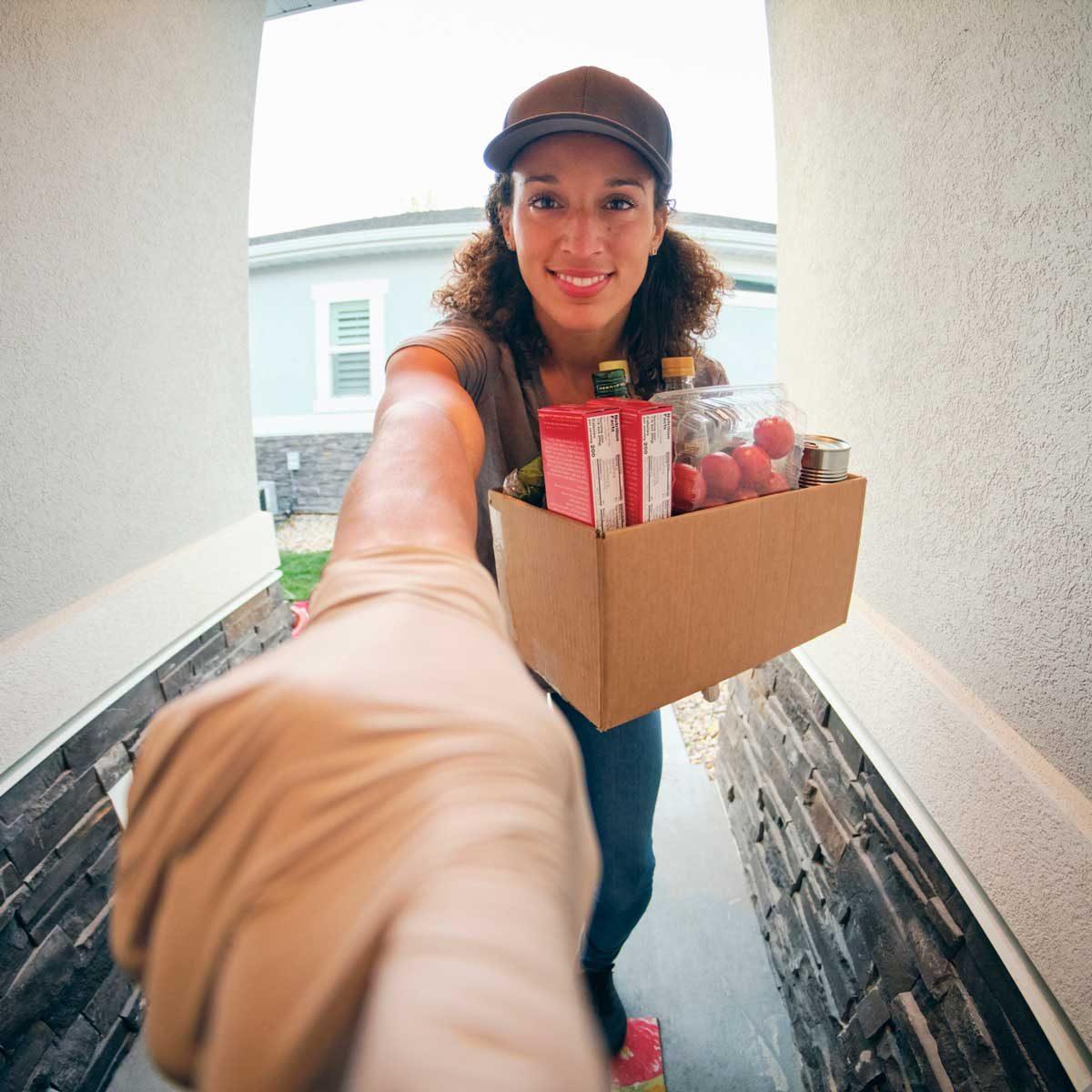 Woman ringing a doorbell