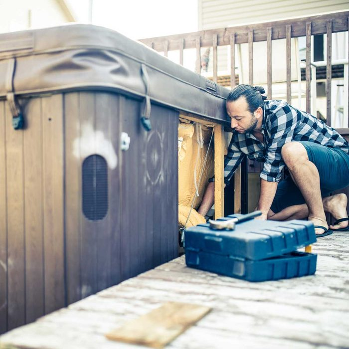 Performing hot tub maintenance