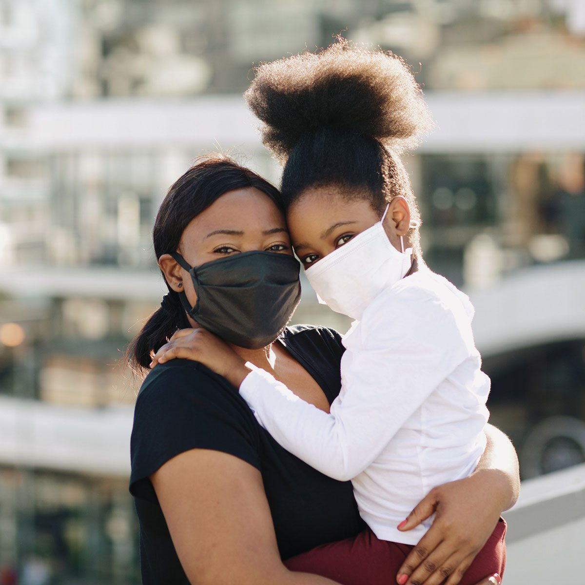 Mother and daughter with face masks