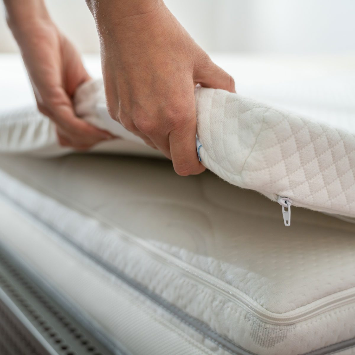 Adjusting a mattress topper