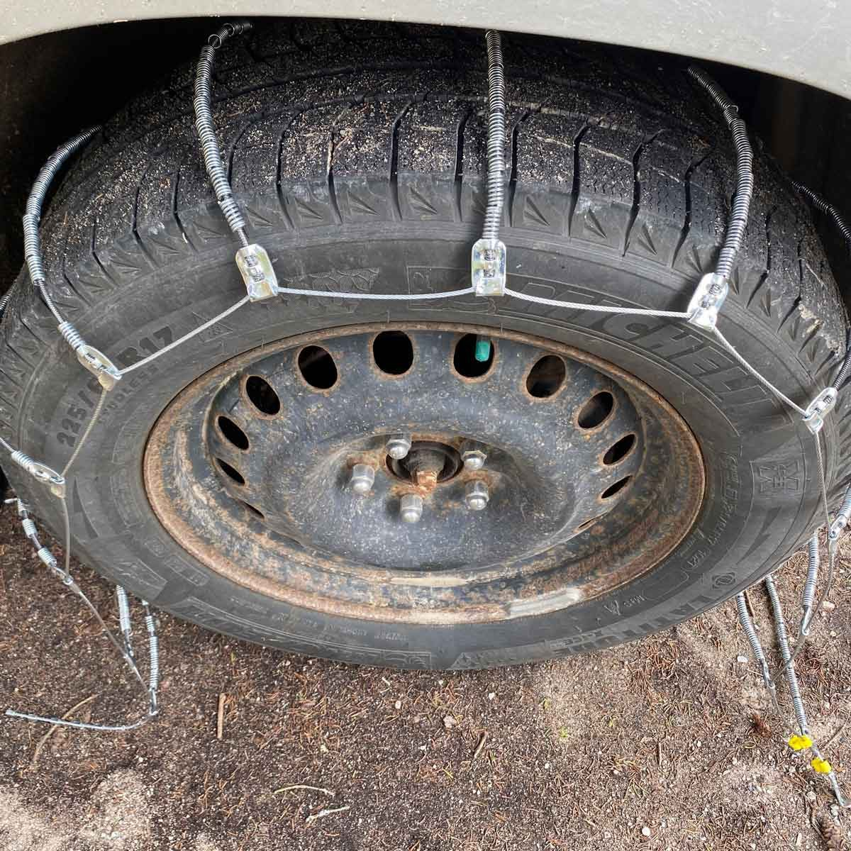 Drape chains over the tires