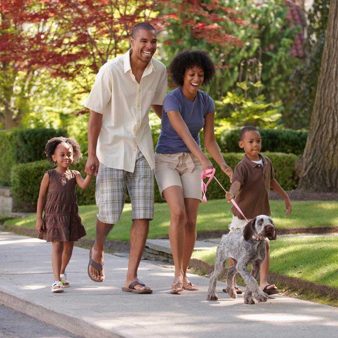 Family walking dog on a leash