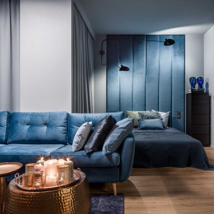 Blue couch in a studio apartment