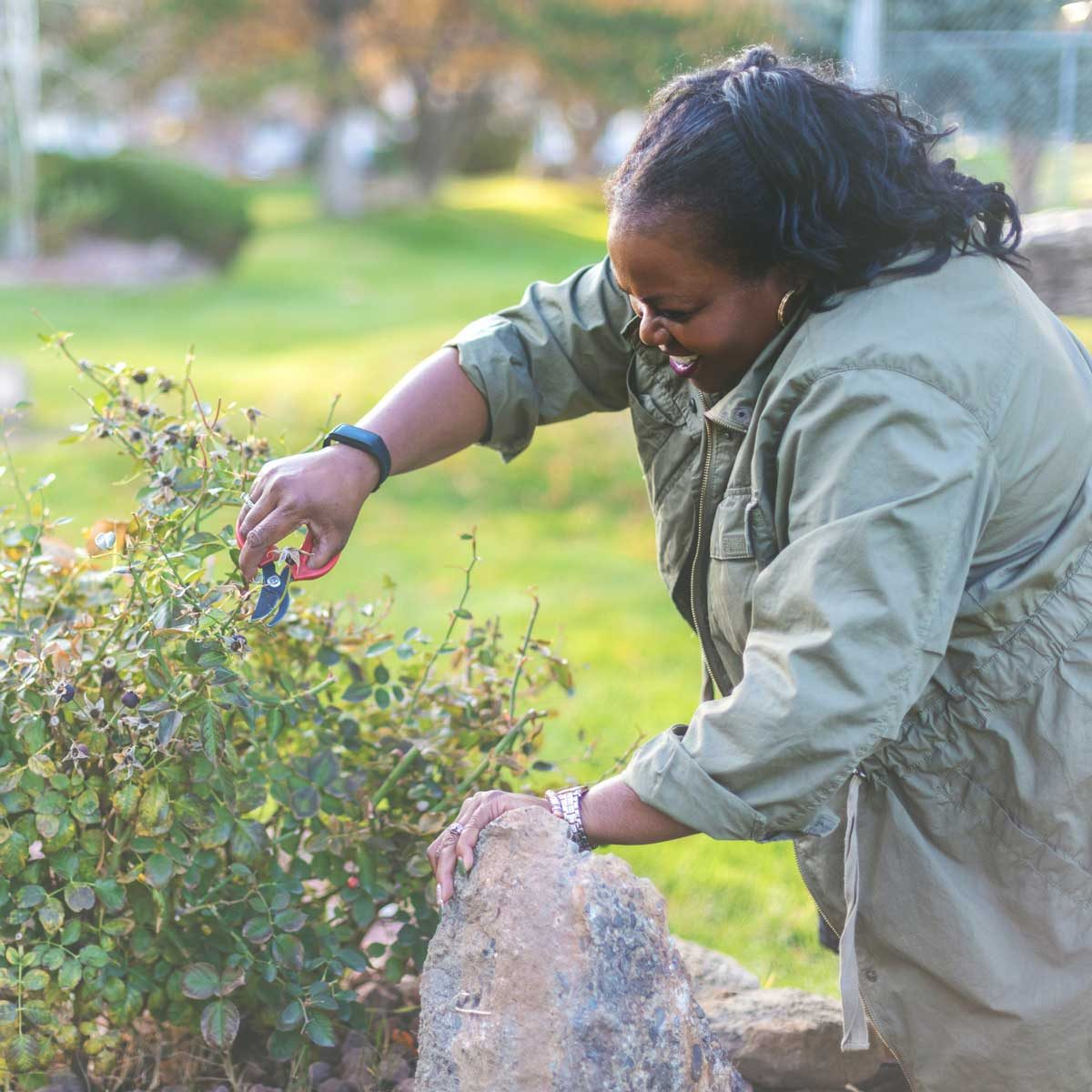 Woman trimming garden in the fall