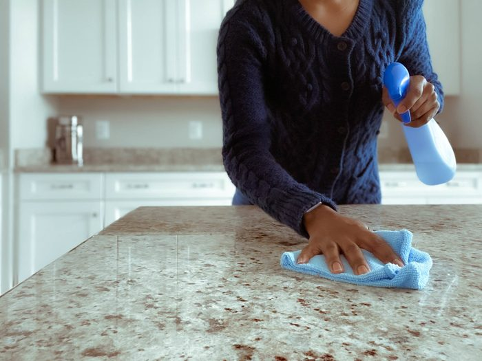 Woman Cleans Kitchen Counter