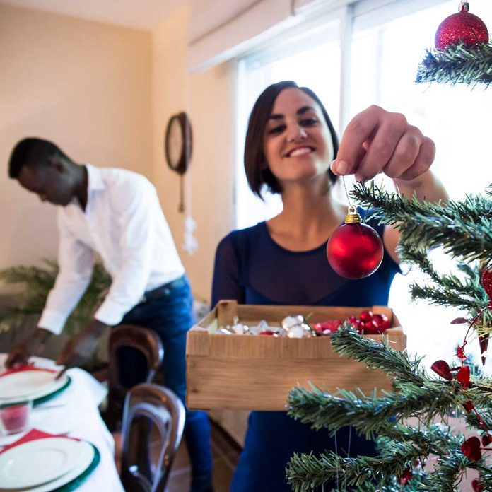 Couple decorating for Christmas