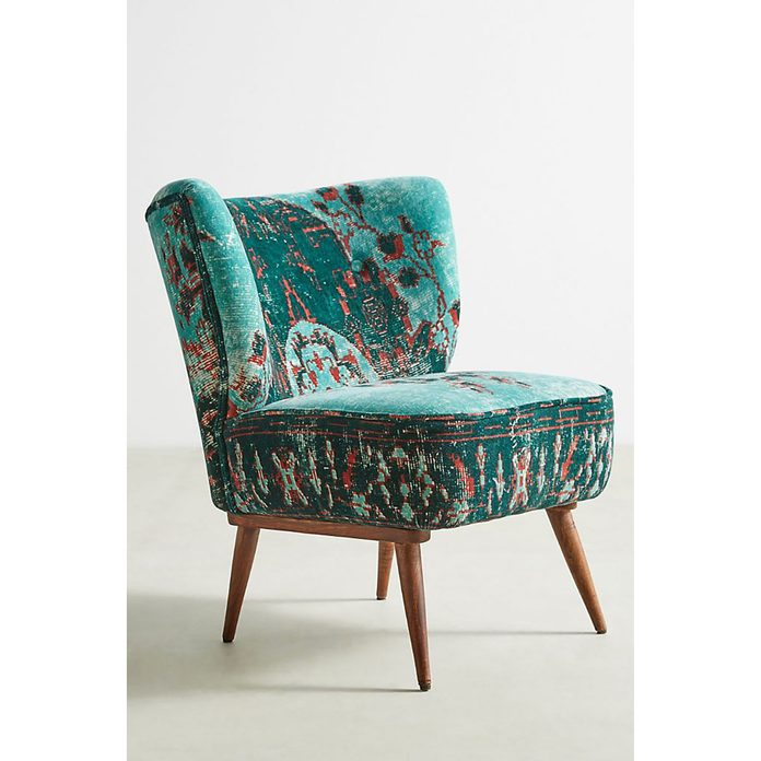 Blue-green chair with red spots