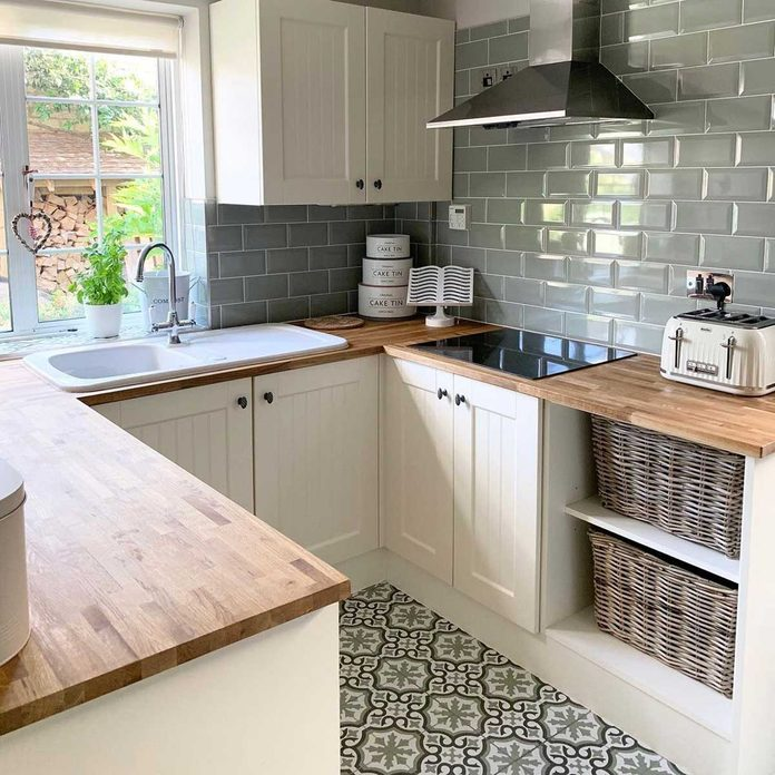 Kitchen with patterned floor tiles