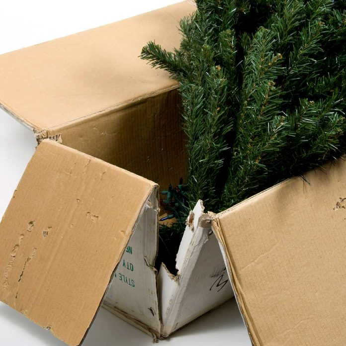 Artificial Christmas tree in an old box