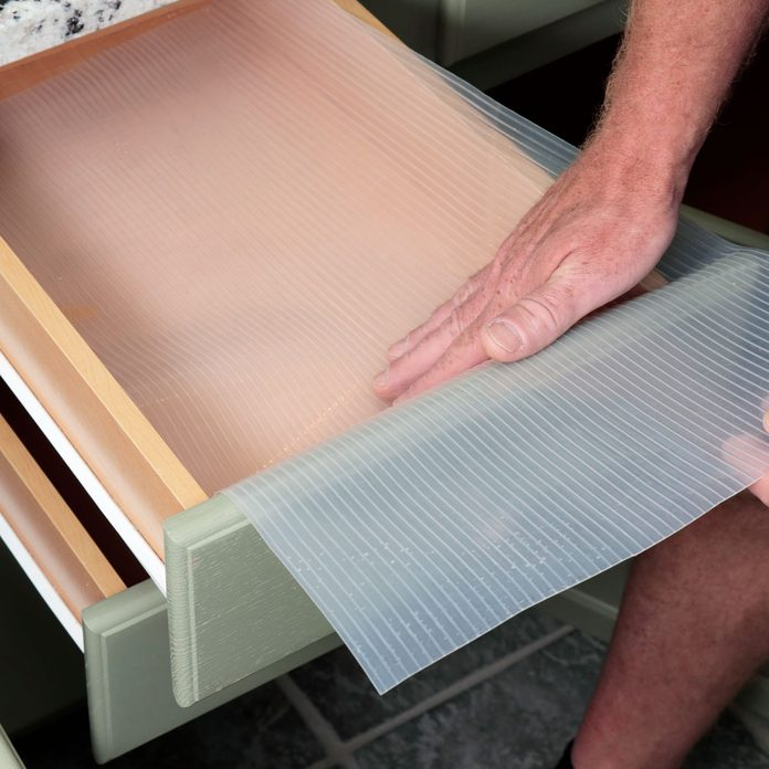 Placing Plastic Drawer Liner in a Bathroom Gettyimages 1195926298