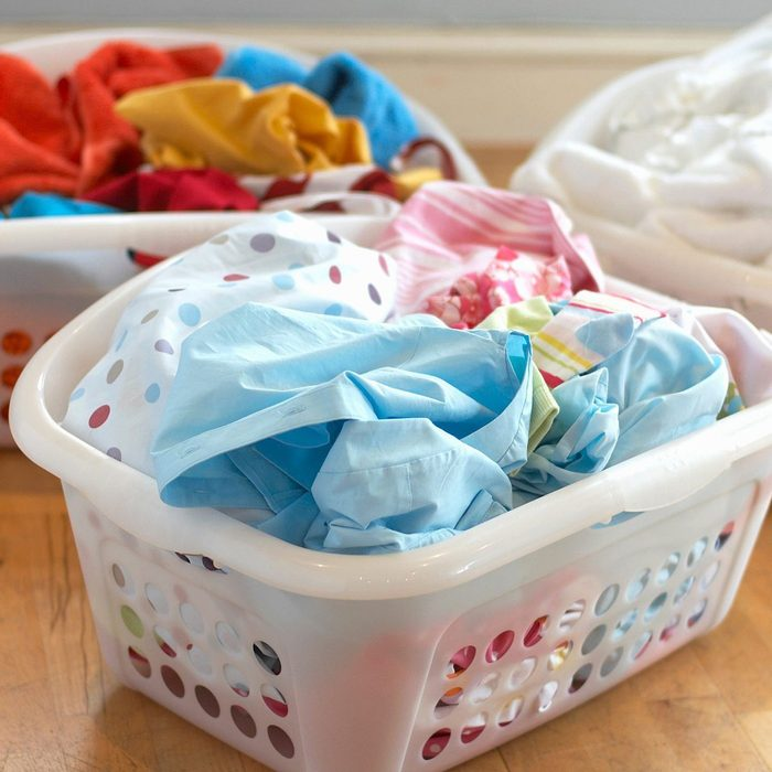 Clean Washing In Three Plastic Laundry Baskets Gettyimages 75493077