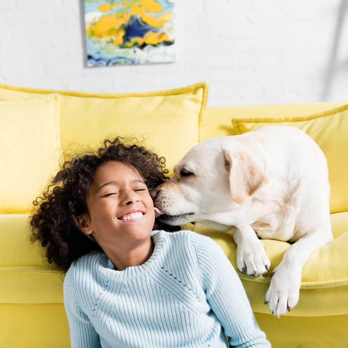 Dog Licking Girl Gettyimages 1285675959