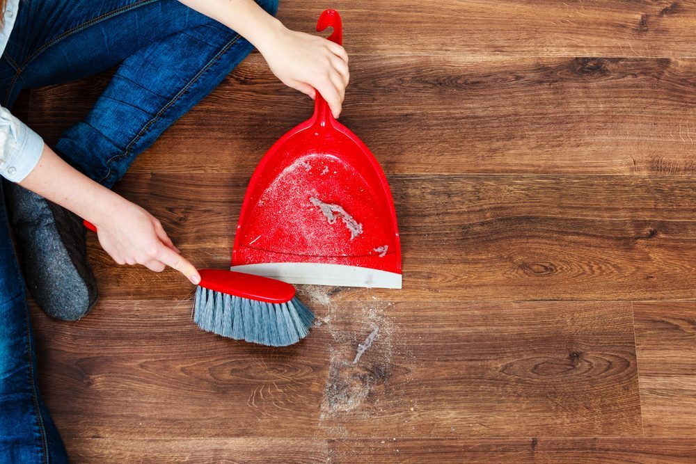 Cleanup Housework Concept Closeup Cleaning Woman Sweeping Wooden Floor With Red Small Whisk Broom And Dustpan Indoor