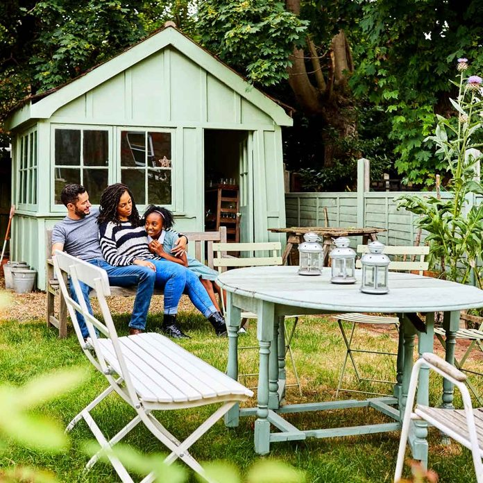 Family in an Outdoor Living Area Gettyimages 610750126