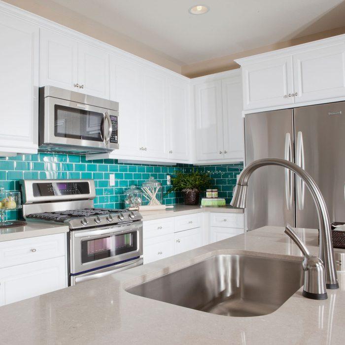 Small kitchen with a blue backsplash