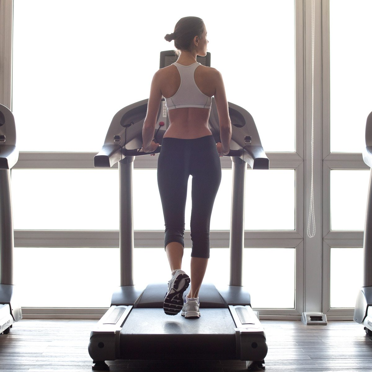 Woman jogging on treadmill at gym Gettyimages 532097165