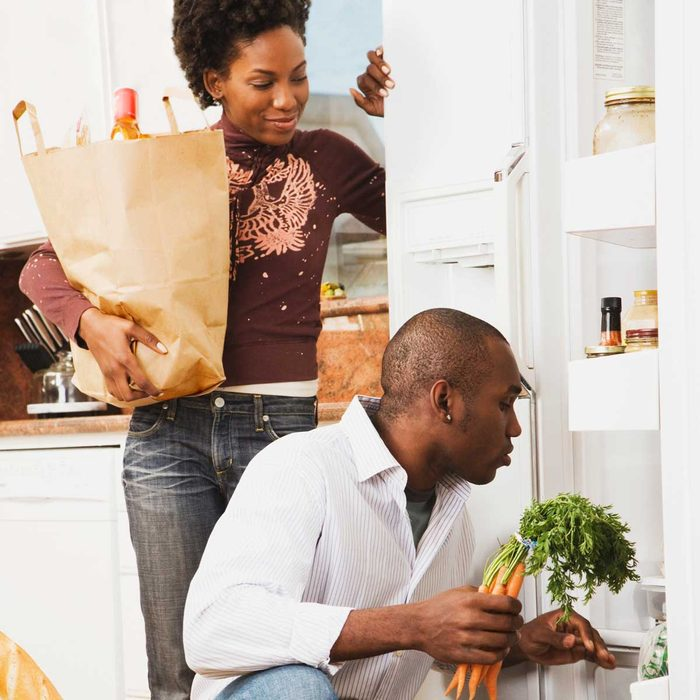 Couple Organizing Kitchen Gettyimages 76132255