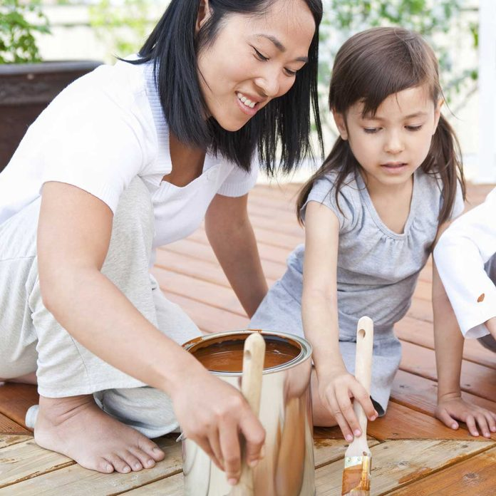 Family Staining Wood Deck Gettyimages 155145297